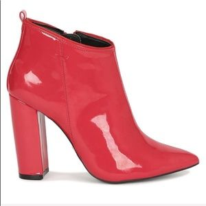 Qupid red booties features a pointy toe front